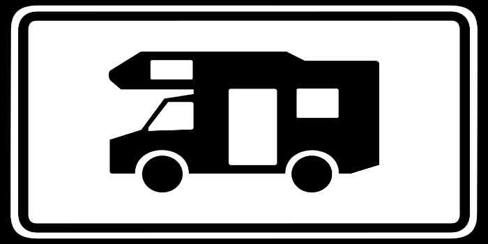 Ein Schild schwarz umrahmt und einem Wohnmobil in der Mitte