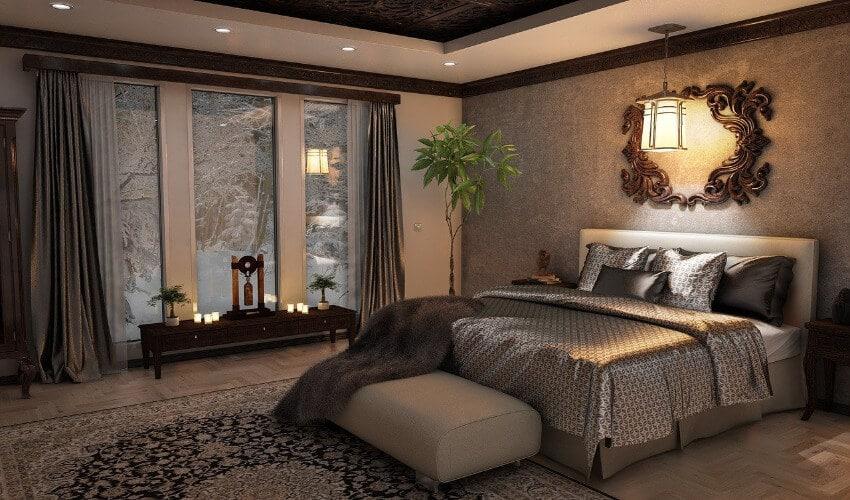 Ein Schlafzimmer mit Grautöne und dunklem edlem Holz.